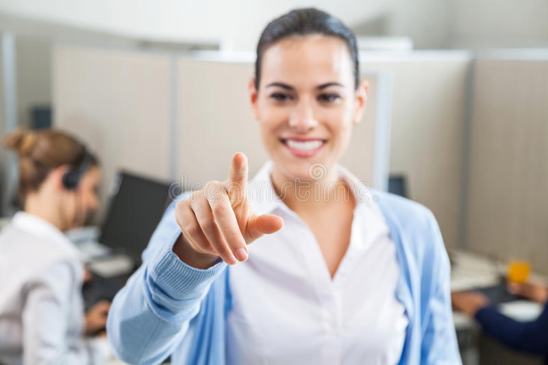 Smiling Female Customer Service Executive Pointing royalty free stock photography