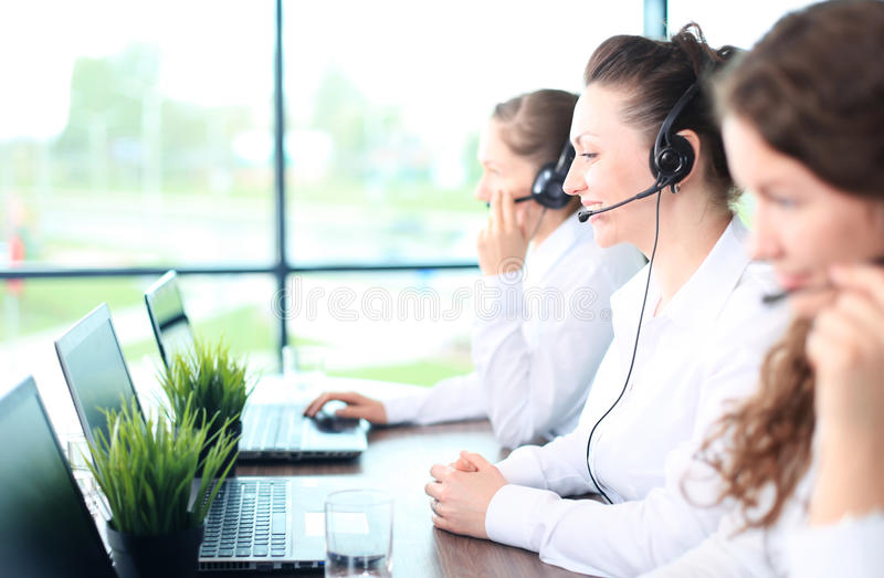 Smiling female customer service stock photos