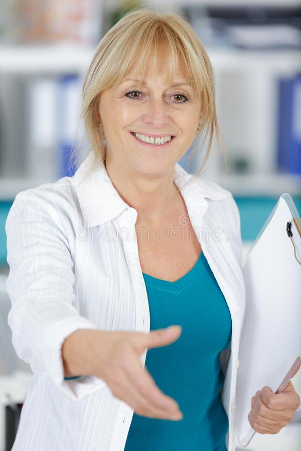 Smiling female doctor during handshake stock images