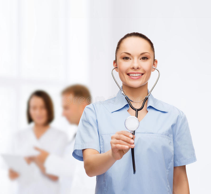 Download Smiling Female Doctor Or Nurse With Stethoscope Stock Photo - Image: 39638146