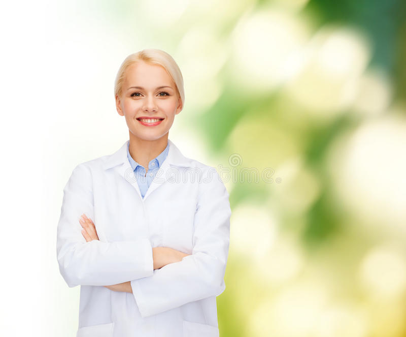 Smiling female doctor over natural background royalty free stock image