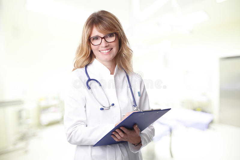 Smiling female doctor portrait royalty free stock photos