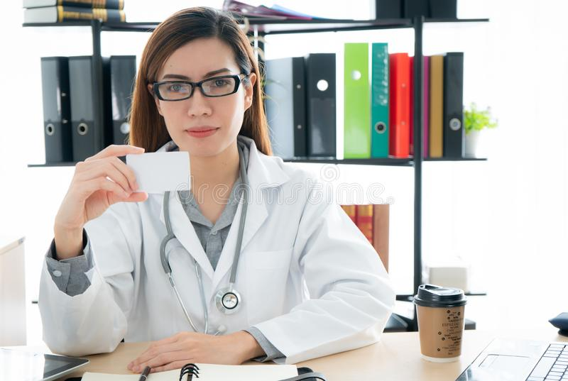 Female doctor showing blank card royalty free stock photo