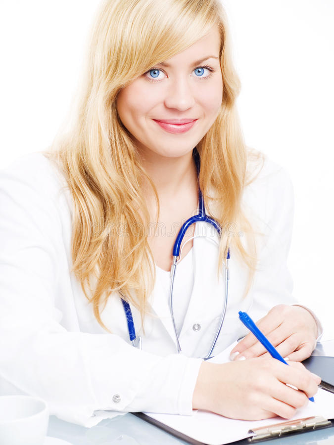 Smiling female doctor with stethoscope making note royalty free stock images