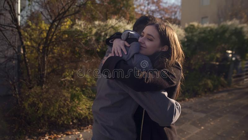 Smiling female embracing male, reconciling after argument, romantic relationship. Stock photo royalty free stock photo