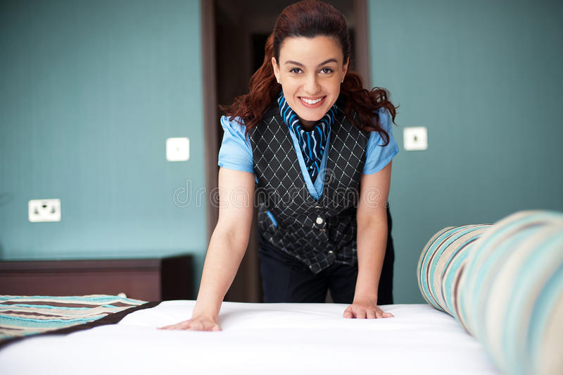 Download Smiling Female Executive Giving Final Touches Stock Images - Image: 26891294