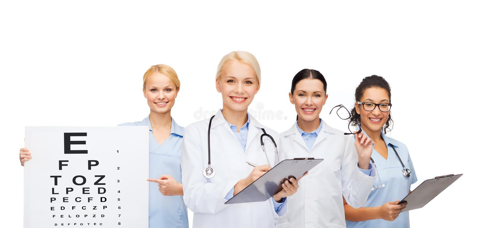 Smiling female eye doctors and nurses. Healthcare, vision and medicine concept - smiling female eye doctors and nurses with eye exam chart, glasses and clipboard stock photos