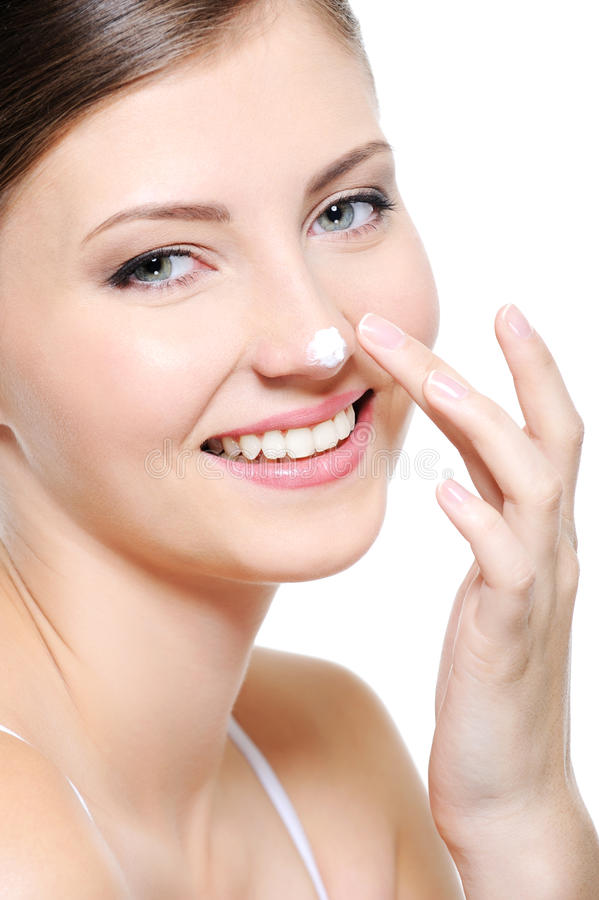 Smiling female face with drop of a cream on nose stock photo
