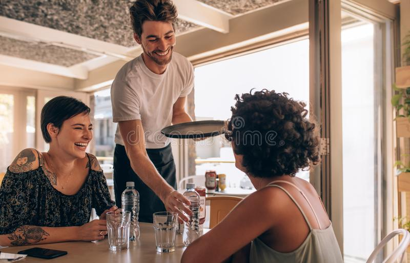 Smiling female friends at a cafe stock photos