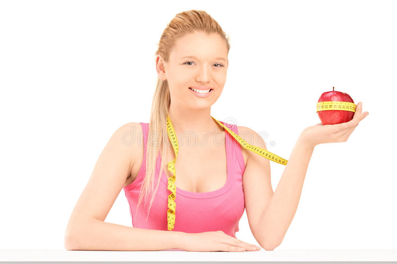 Download Smiling Female Holding An Apple Wrapped With Measuring Tape Stock Photo - Image: 28405578