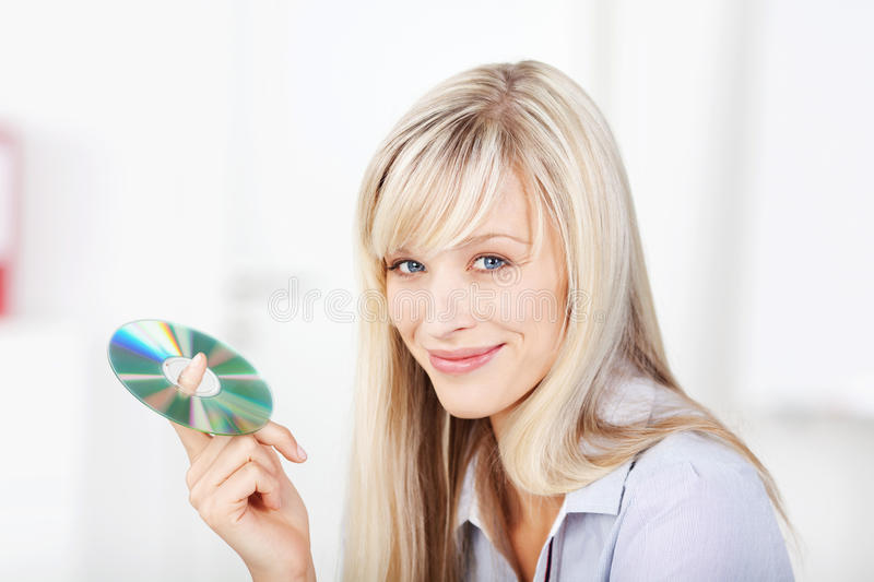 Smiling female holding cd stock images