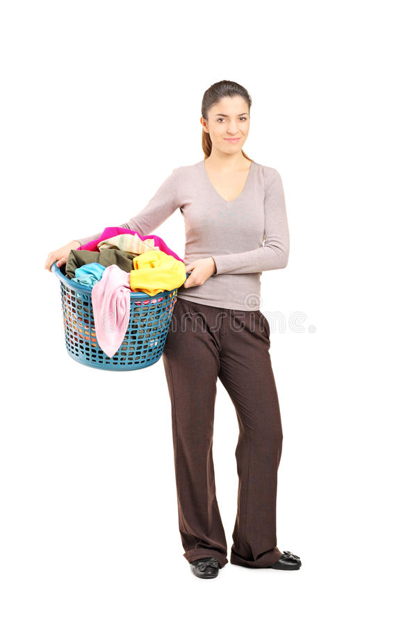 Smiling female holding a laundry basket