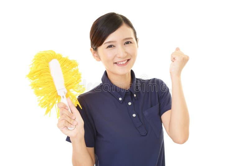 Smiling female janitor stock image