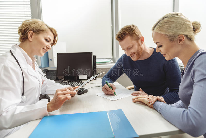 Smiling female medico at working place stock photo