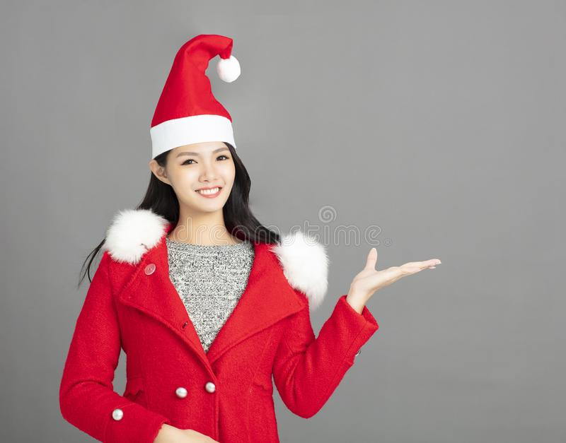 smiling female model wear santa hat stock photos