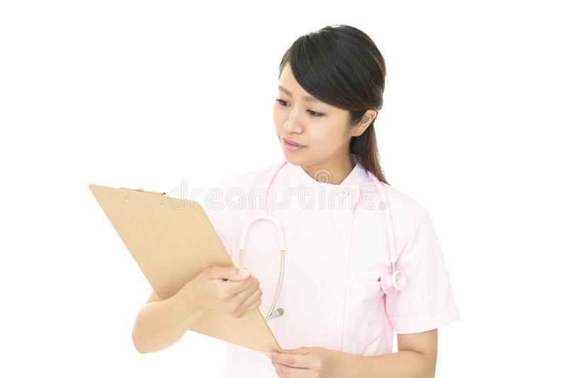 Smiling female nurse royalty free stock images