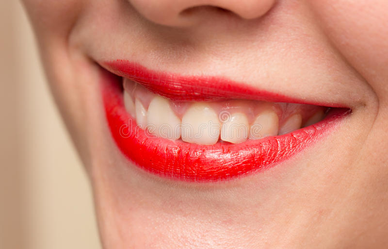 Smiling female red lips and healthy white teeth closeup shot with stock photography