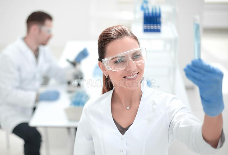 Smiling female scientist standing in the lab stock image