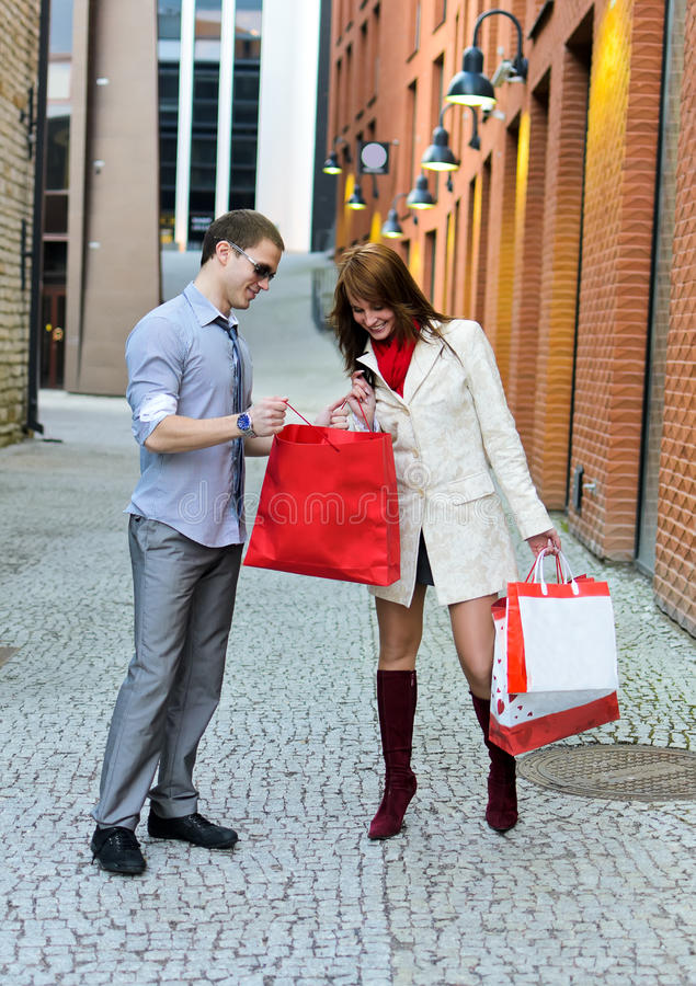 Smiling female shows purchases