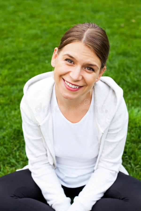 Smiling female with sporty outfit stock images