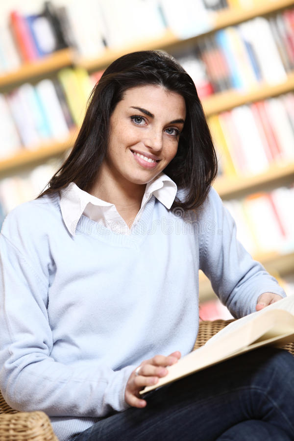 Smiling female student with book royalty free stock image