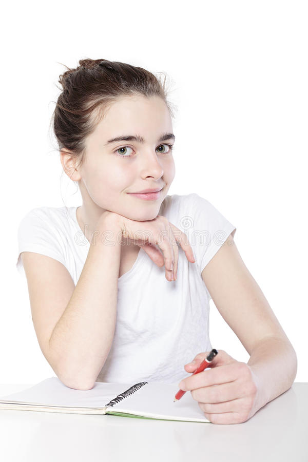 Smiling female teenager with blank note book