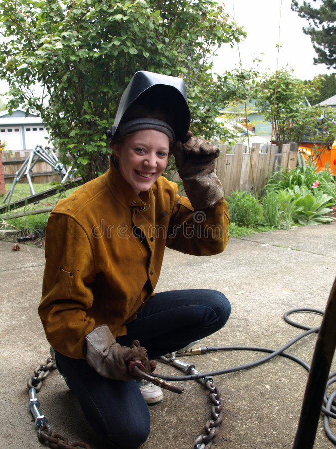 Smiling Female Welder royalty free stock images