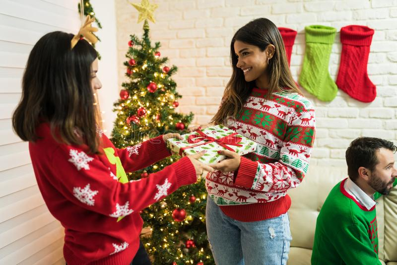 Smiling Females Exchanging Christmas Presents At Home stock images