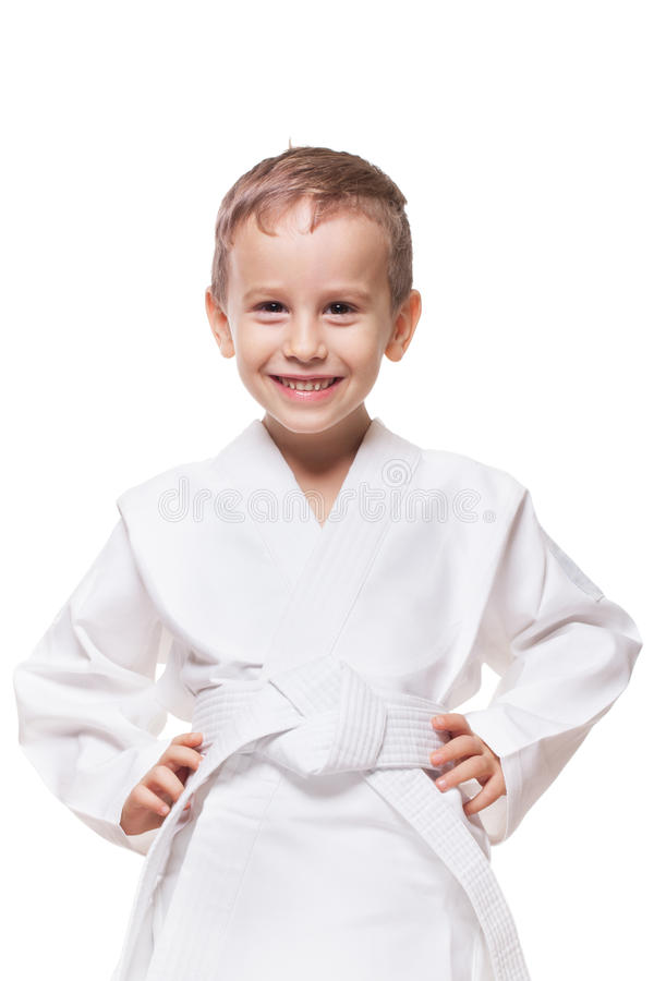 Smiling fighter. Smiling charming kid in brand new kimono on isolated white royalty free stock photography