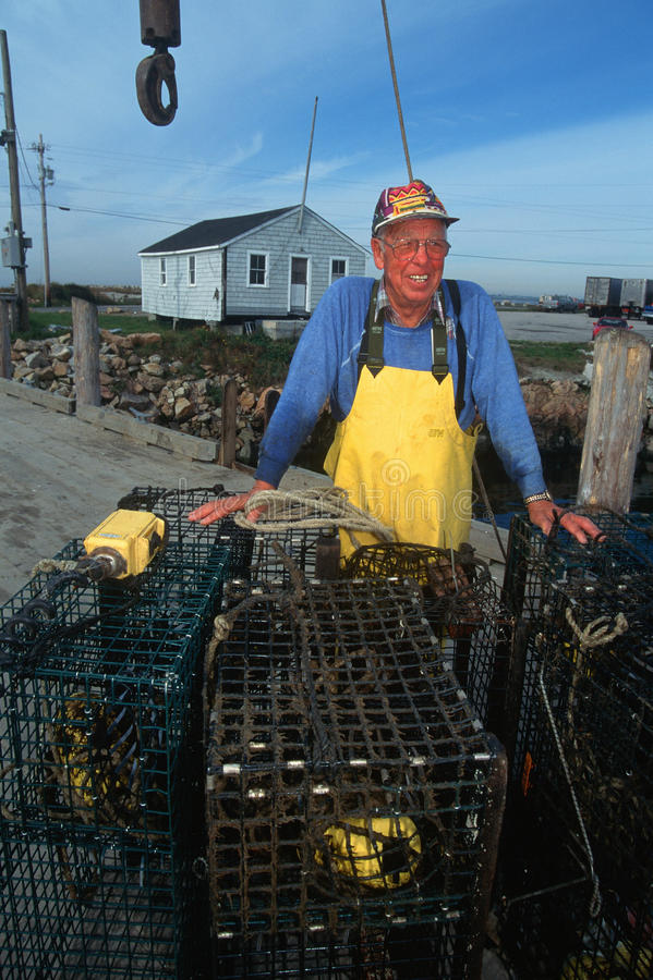 Smiling fisherman with lobster traps, Sakonnet, Rhode Island stock images