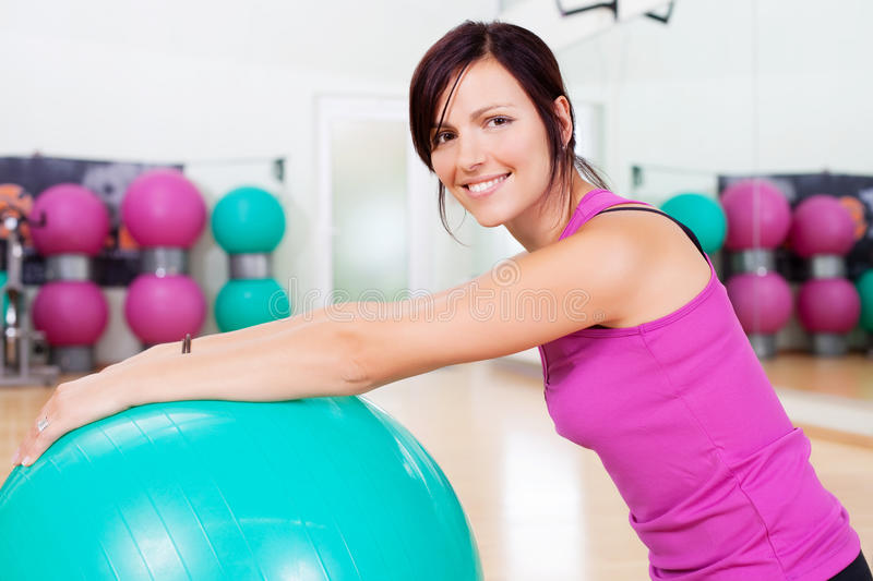 Smiling fit woman royalty free stock photo