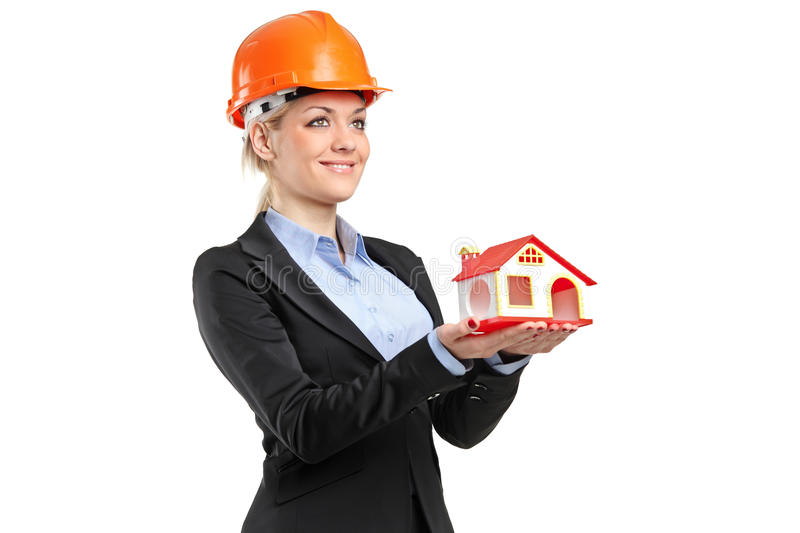 Download A Smiling Forewoman Holding A Model House Stock Photo - Image: 18546852