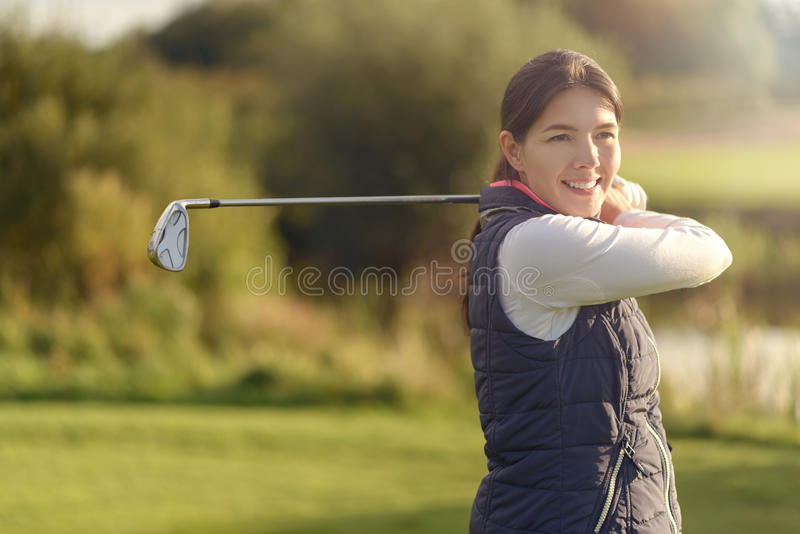 Smiling friendly young woman golfer stock photos
