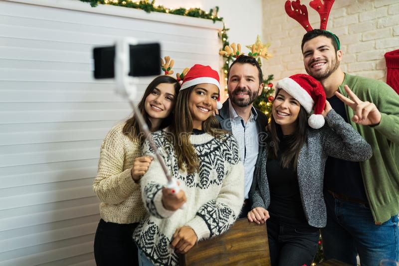 Smiling Friends Celebrating Christmas With Selfie At Home stock photos
