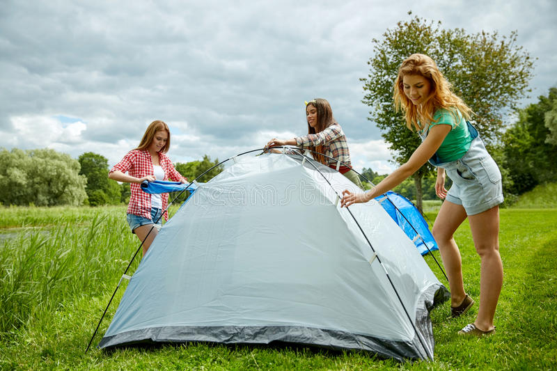 Download Smiling Friends Setting Up Tent Outdoors Stock Image - Image 59129311 & Smiling Friends Setting Up Tent Outdoors Stock Image - Image: 59129311