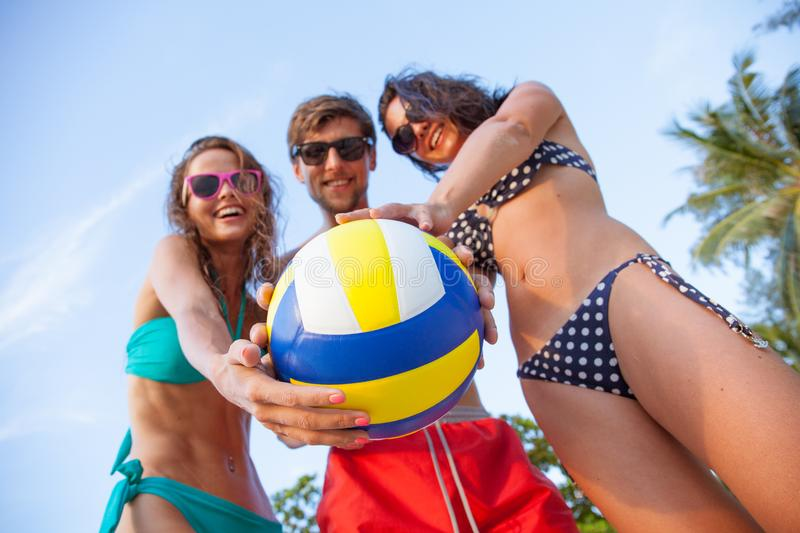 Smiling friends with volleyball royalty free stock image