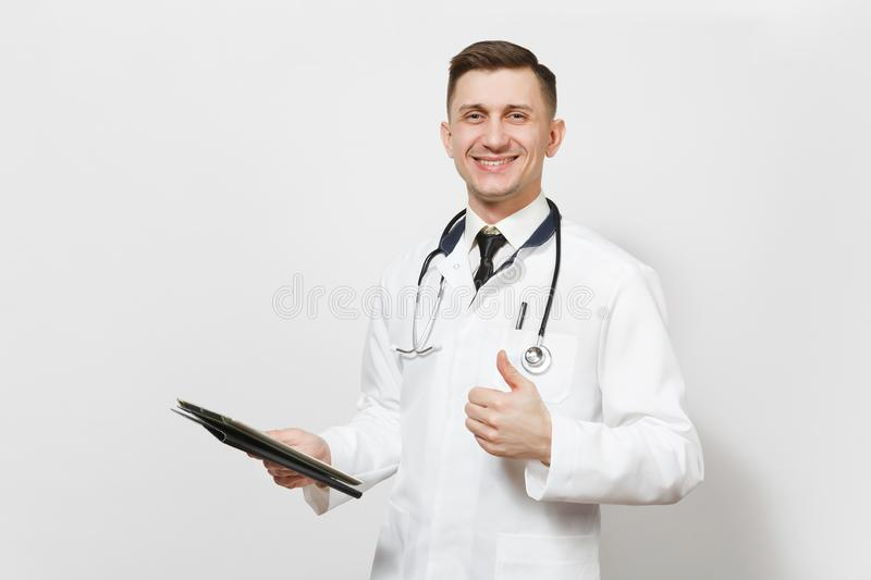 Smiling fun young doctor man isolated on white background. Male doctor in medical uniform, stethoscope holding tablet pc royalty free stock images