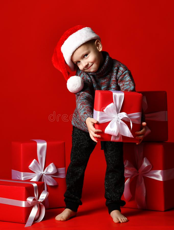 Child holding Christmas gift box in hand stock photography