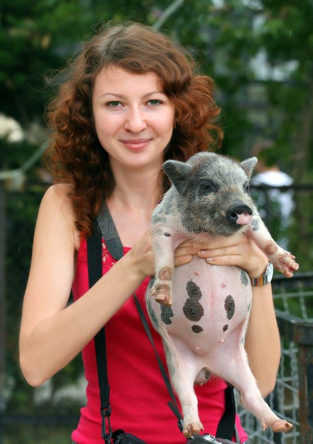 Free Smiling Ginger Girl Holding Piglet Royalty Free Stock Photos - 16234368