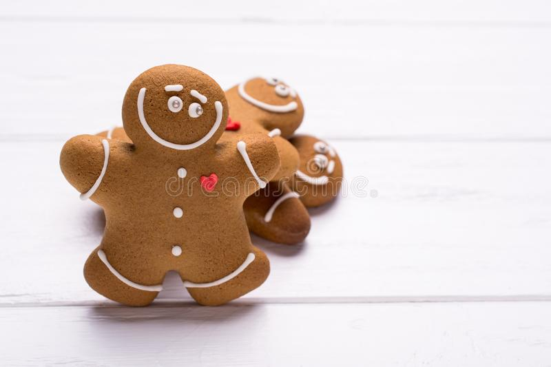 Smiling gingerbread men cookies, on white background with copy-space for recipe. Smiling gingerbread men cookies, on white background with copy-space for royalty free stock photos