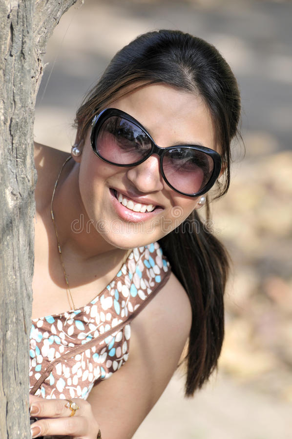 Download Smiling girl stock photo. Image of chain, india, goggles - 13318550