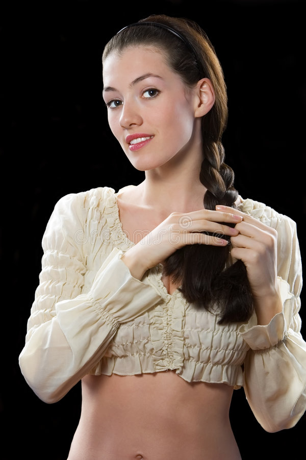 Smiling girl 2. White smiling girl on the black background stock photo