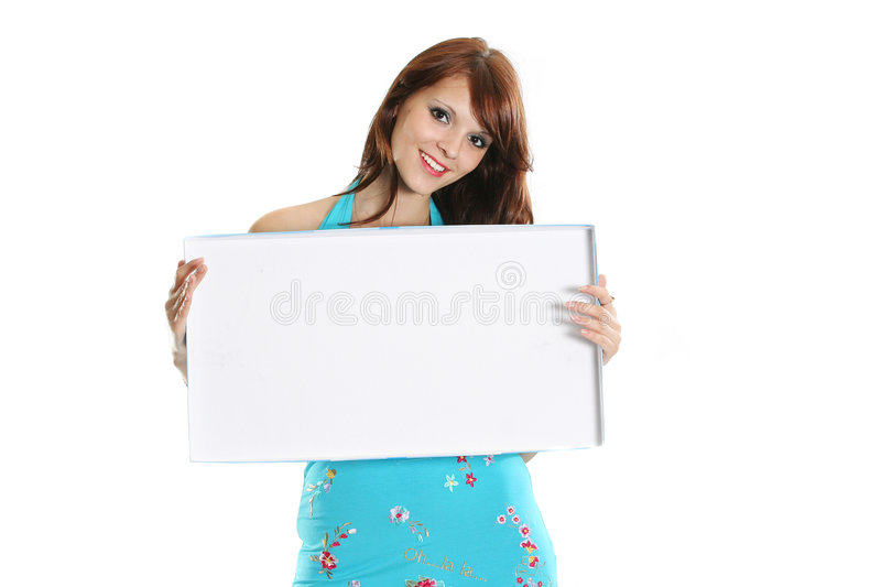 Smiling girl. The beautiful girl holds the form for advertising stock images