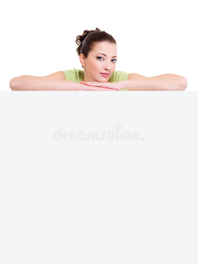 Smiling Girl Above The White Blank Billboard Stock Photos