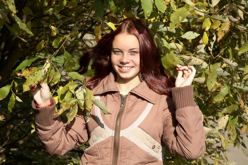 Download The Smiling Girl Against A Tree Stock Photos - Image: 16220023