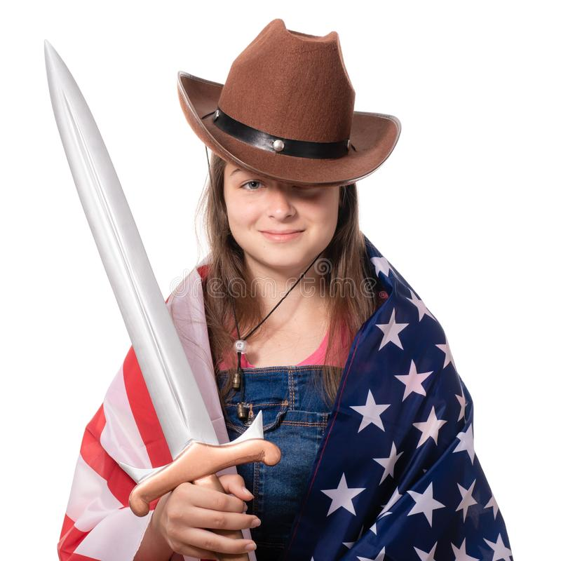 Smiling girl with american flag and sword royalty free stock photo