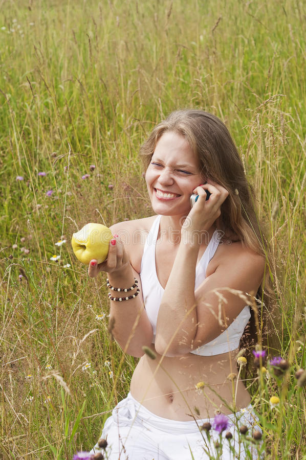 Smiling girl with apple stock photo