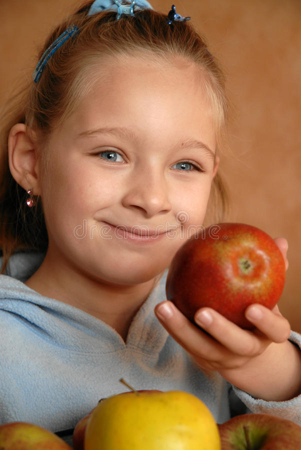 Smiling Girl With Apples Stock Images
