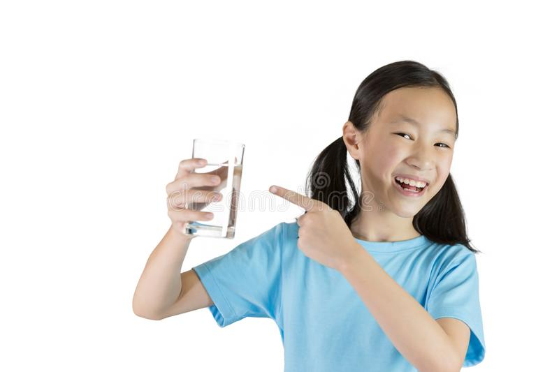 Smiling girl,Asian gril holding a glass of water isolated on white background,Life can't live without drinking water. stock image