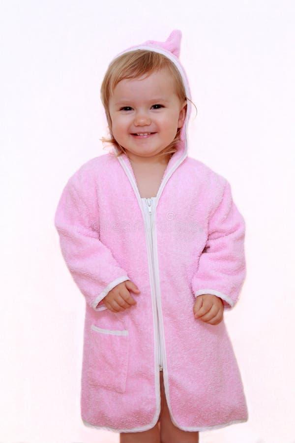 Smiling girl in bathrobe